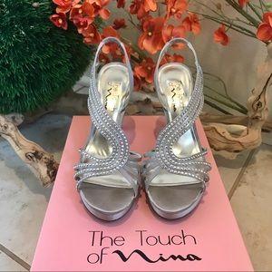 Silver heels embellished with rhinestones